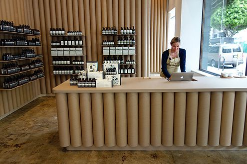 Aesop's simple, chic interior is made up of thick cardboard tubes