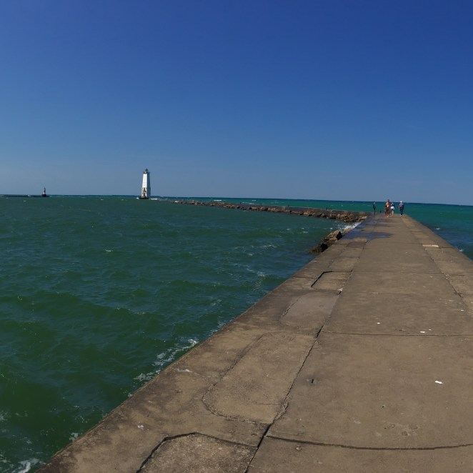 The breakwater walk out to the Frankfort North Light at the city beach in downtown Frankfort.