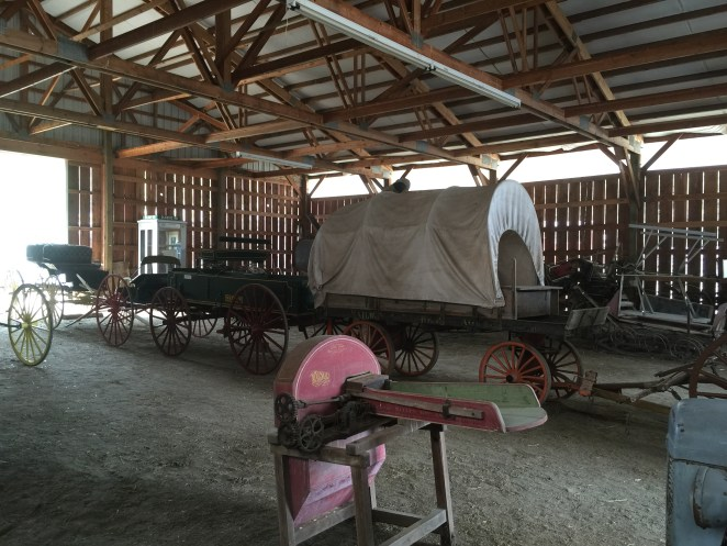 Historical farm tools and wagons and buggies