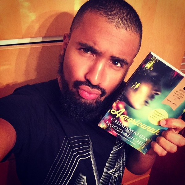 Of course, Purple Hibiscus is on the only book worthy of such a pout. (instragram via @malcolmmusic