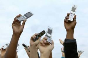 Crowd Holding Phones in Air
