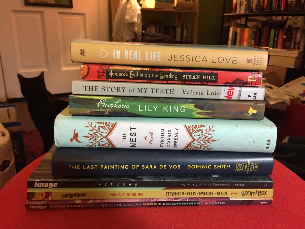 My reading pile the night before Dewey's 24-Hour Readathon, Spring 2016 (You can see my cat, Minerva, in the background)