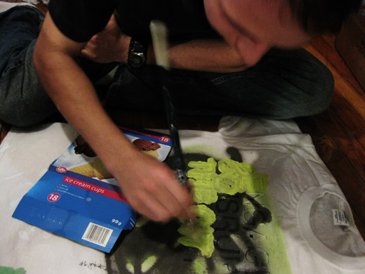 josh begins painting the shirt