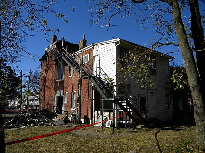 923 First Street after a fire (Broken Sidewalk)