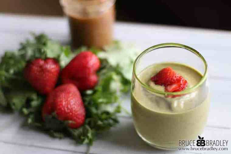 Spring into better health with this delicious Strawberry Green Smoothie made with a mix of strawberries, healthy greens, bananas, and almond butter!