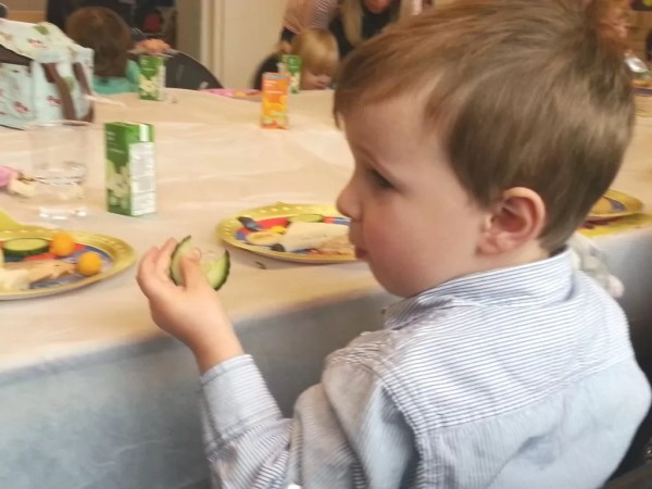 toddler eating birthday tea