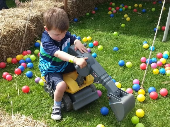 scooping balls in a digger