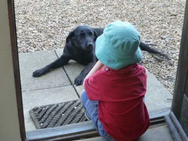 One boy and his dog - on the door step