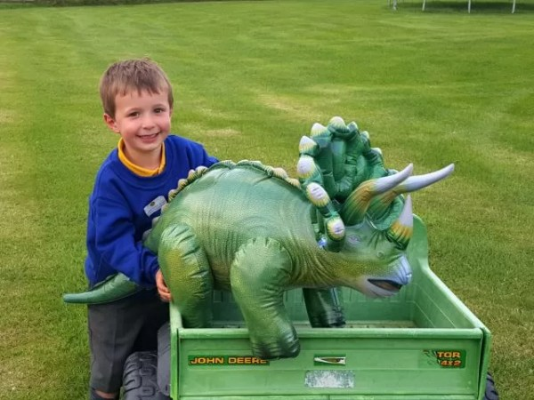 happy with the giant dinosaur