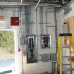 A commercial electrical panel addition to a retail space.