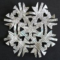 Cut Out Snowflakes from Newspaper
