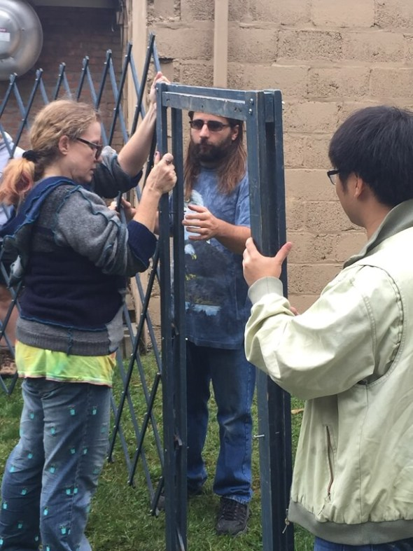 Attaching the yurt door.