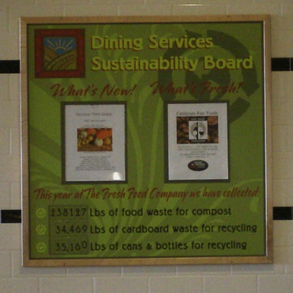 Dining Services Sustainability Board at the west campus dining hall reports composting and recycling numbers. | Photo by Lisa Dukart