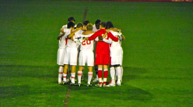 The Terriers huddle together just before the game kicks off | Photo by Jenny Cahill