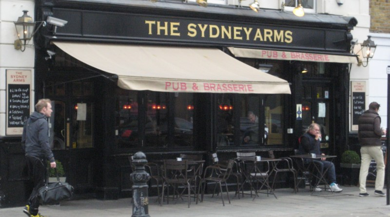 "This is a pub. You can tell because it has the word ""Arms"" in its name. 
