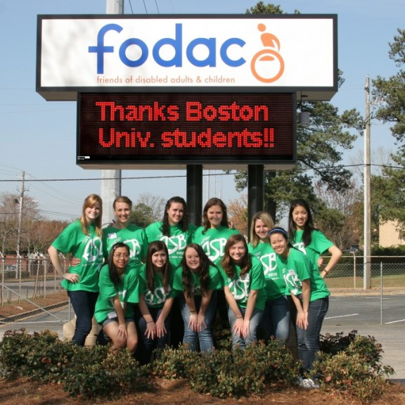 When we were asked to pose for a picture at FODAC our last day, the staff surprised us by posting a thank-you message on the screen behind us. | Photo by Ron Hess