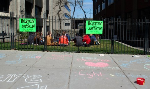 """Students wrote encouraging messages on the ground in colorful chalk for the """"Boston Will Sustain"""" project. 