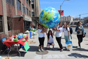 CGS Community Service Club members hold finished paper maché globe. | Photo by Heidi Chase