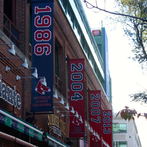 The new 2013 banner joins others outside Fenway Park
