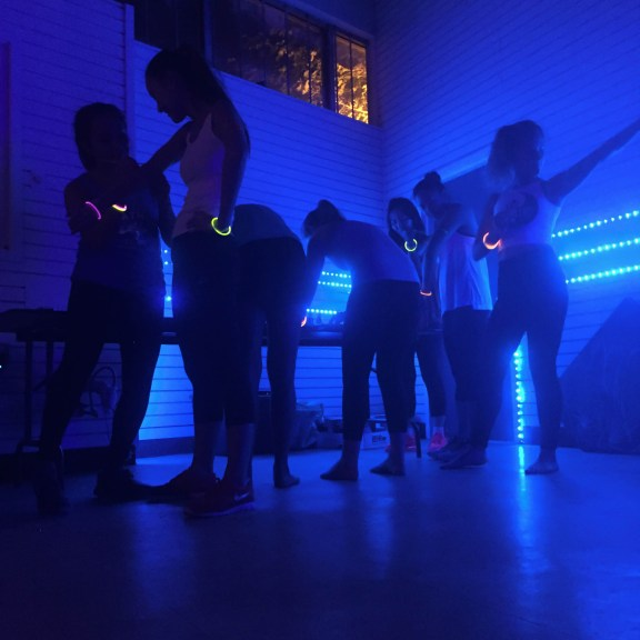 """Glow Yoga is a familiar practice with a twist. """"Everyone has their own reasons and goals in practicing yoga and everyone has their own preferences and style. I definitely think [Glow Yoga] accommodates one segment of yoga lovers,"""" Singer says.