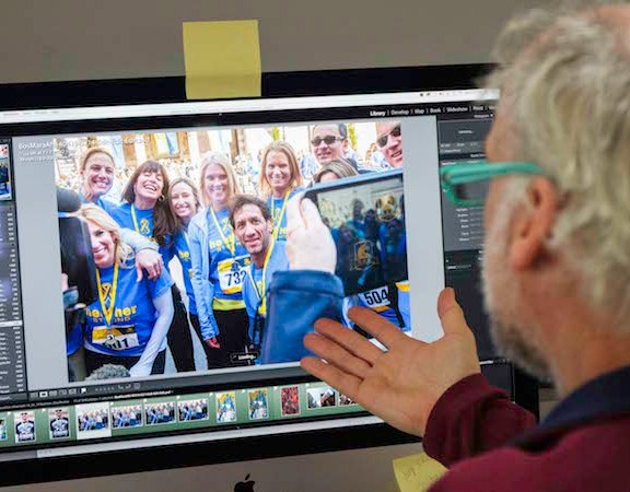 Joshua Touster flips through the photos he took at the 2015 Boston Marathon while editing his images on Lightroom.