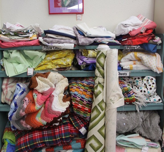 When they first moved to their current neighborhood in Portland, Oregon, Joe Hilsenrad and Angela Homme, co-owners of Rerun, felt the need to start a resale store so that people would have a place to go with unwanted, yet valuable items like this colorful stock of blankets and linens.