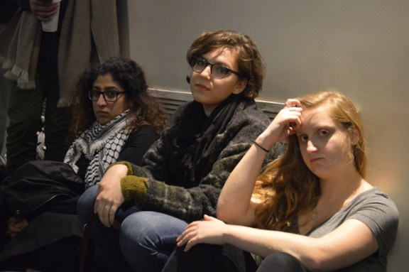 A group of women listen to talk about multiculturalism.