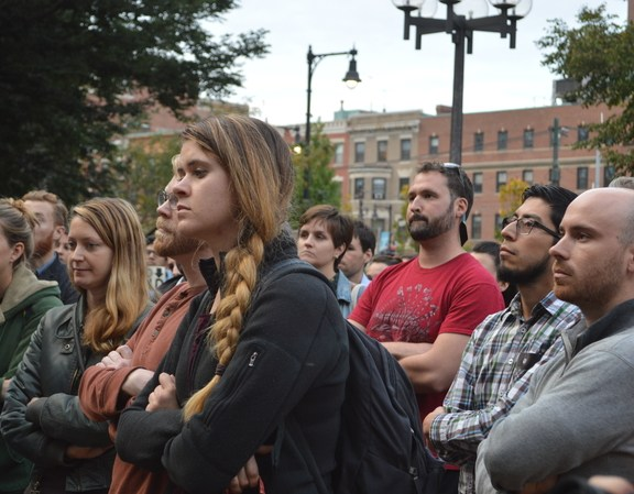 Students listen to speakers.