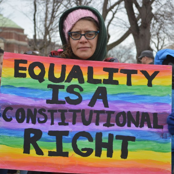 """Emily Ross of Belmont said """"This is the same sign I carried a year ago."""" She also said she is """"still here, still fighting."""" Photo by Carolyn Komatsoulis"""
