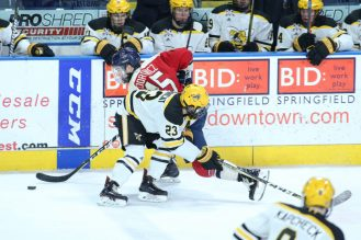 January 26,2018; Springfield, Massachusetts, United States; Robert Morris Colonials forward Spencer Dorowicz (15) is checked by AIC Yellow Jackets defenseman Andrew DeBrincat (23) during a conference matchup between Robert Morris and AIC won by the Yellow Jackets 3-1 at the MassMutual Center. Photo: Brian Foley-Foley Photography.