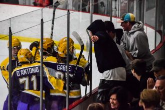 The Plum Mustangs celebrate their first-period game-tying goal in front of the Upper St. Clair student section Monday night at Ice Castle -- ED MAJOR II