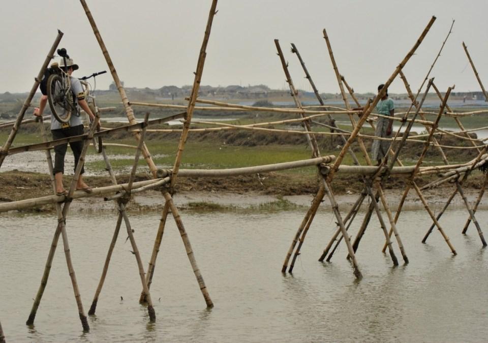 Crossing a bamboo bridge