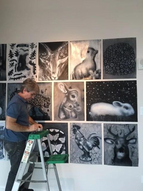 Joe Peragine creating an installation of drawings at 1065 Midtown.