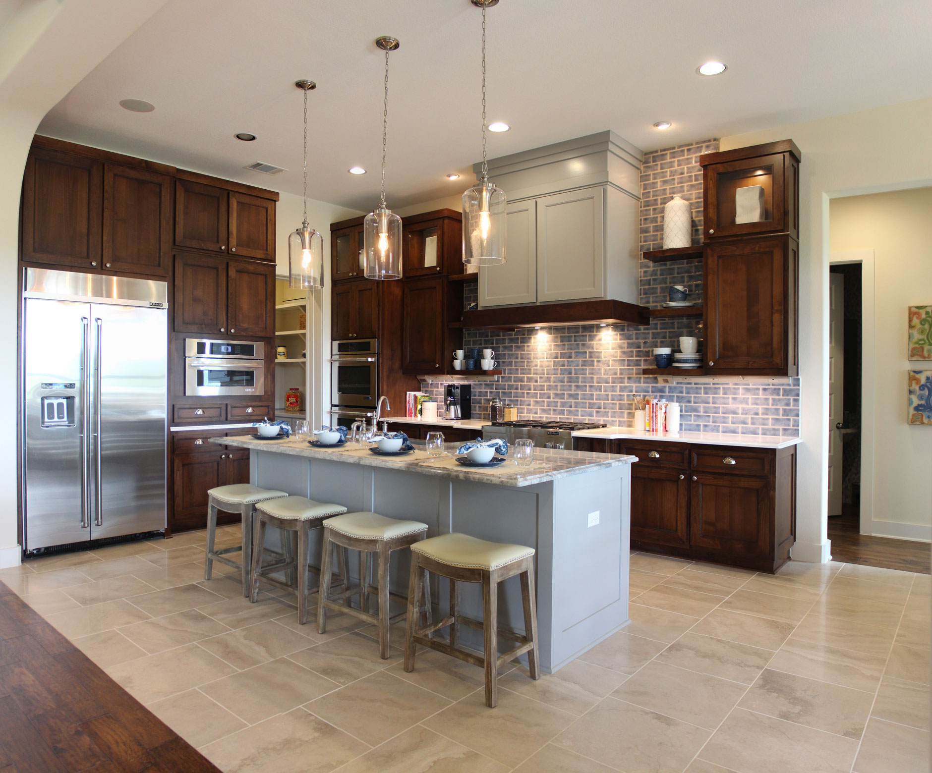 choose flooring compliments cabinet color staining kitchen cabinets Burrows Cabinets kitchen cabinets in stained perimeter cabinets and gray island Craftsman range hood and