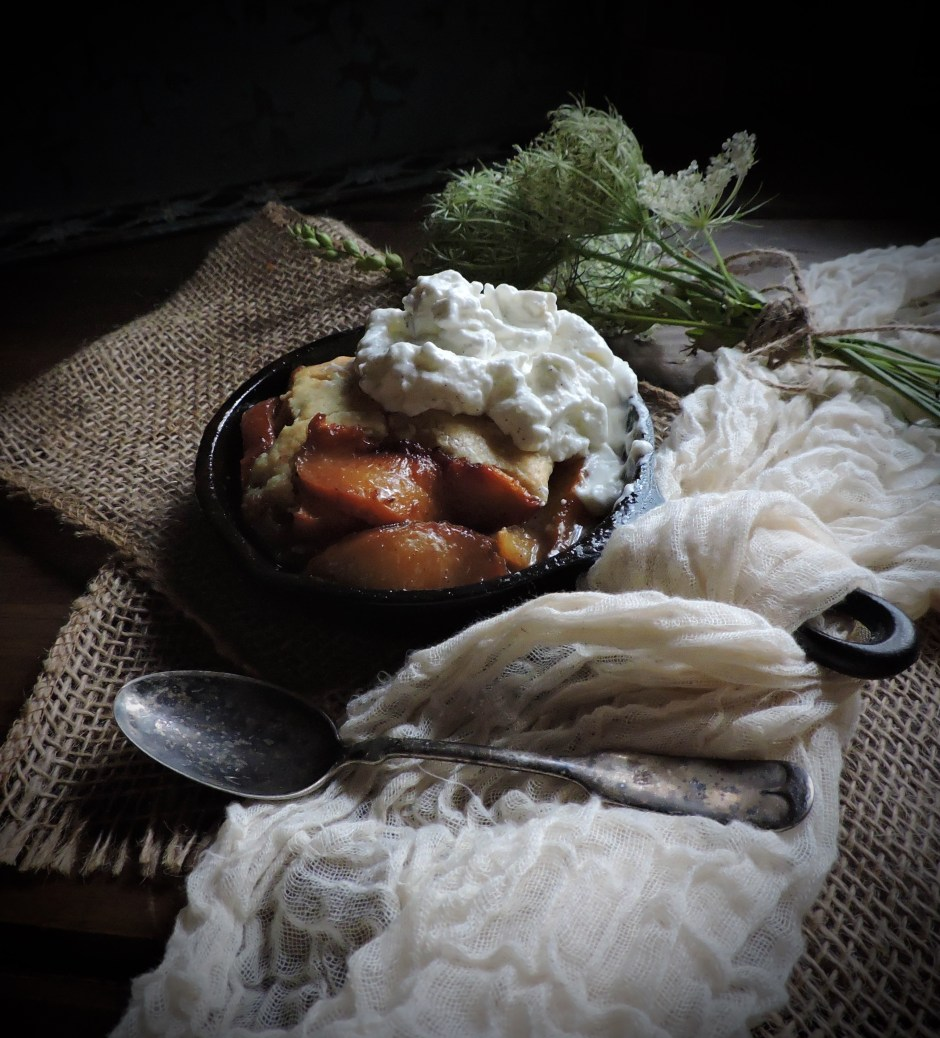 Peach Cobbler...Bursting with flavor...peaches, so sweet in their own right, are sautéd in butter, brown sugar, and cinnamon to make a deliciously fruity caramel sauce.  A moist cake topping is so delicious with the fresh peaches...and a generous dollop of vanilla bean whipped cream over the warm cobbler melts over the peaches and into the caramel sauce, for delectably creamy bite after bite.