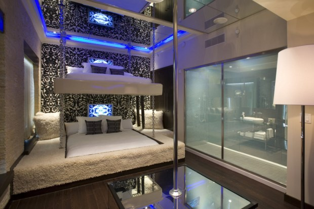 Furry bunk beds, stripper pole front and center, glass-walled bathrooms at right.