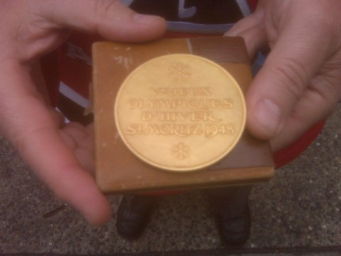 The front of the 1948 gold medal for hockey at the Winter Olympics.