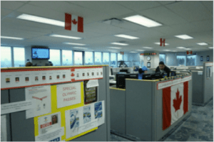 The call centre is filled with Olympic spirit: it's been decorated with Canadian flags, photos of Olympic athletes, pictures, posters, and useful maps of various Olympic sites.