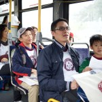 Campers play a game while riding back to Edmonds Station