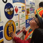 Joshua checks out the many signs made at Burnaby Transit Centre!