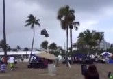 Waterspout hurls bouncy house off beach injuring 4 children