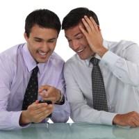 Two businessmen sharing jokes