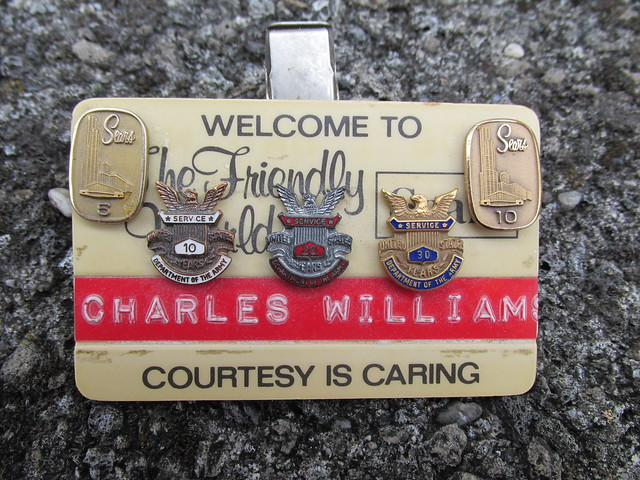 Courtesy is Caring - Sears name badge
