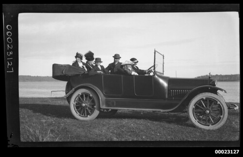 Six people, including Captain Edward Robert Sterling, in a car