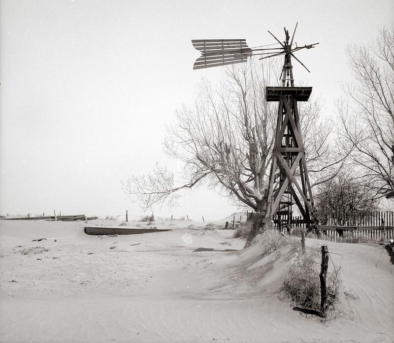 Rothstein, Arthur, photographer. Windmill and tank on an abandoned farm. Cimarron County, Oklahoma. Apr, 1936.