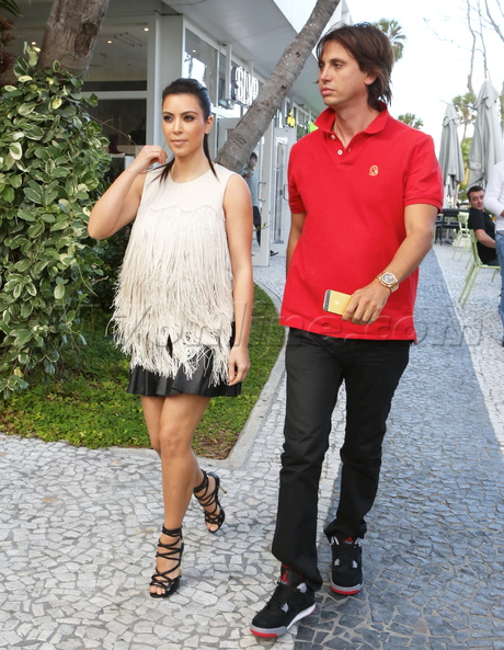 Kim Kardashian and Jonathan Cheban making crazy faces while filming