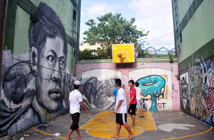 graffiti in public housing yard with makeshift basketball court 3