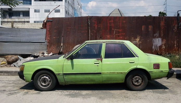 green Mitsubishi Lancer car 1