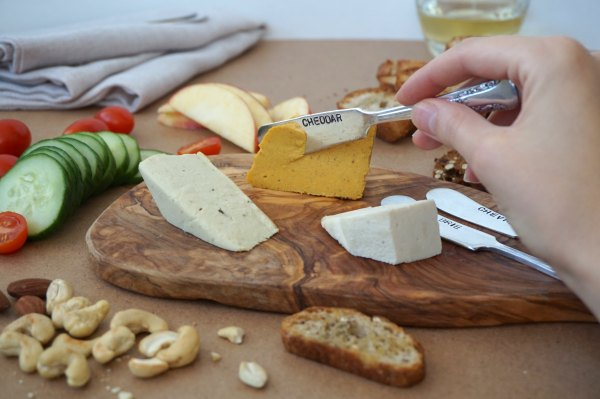 Nuts For Cheese Board Slicing Cheddar | thelittleredspoon.com