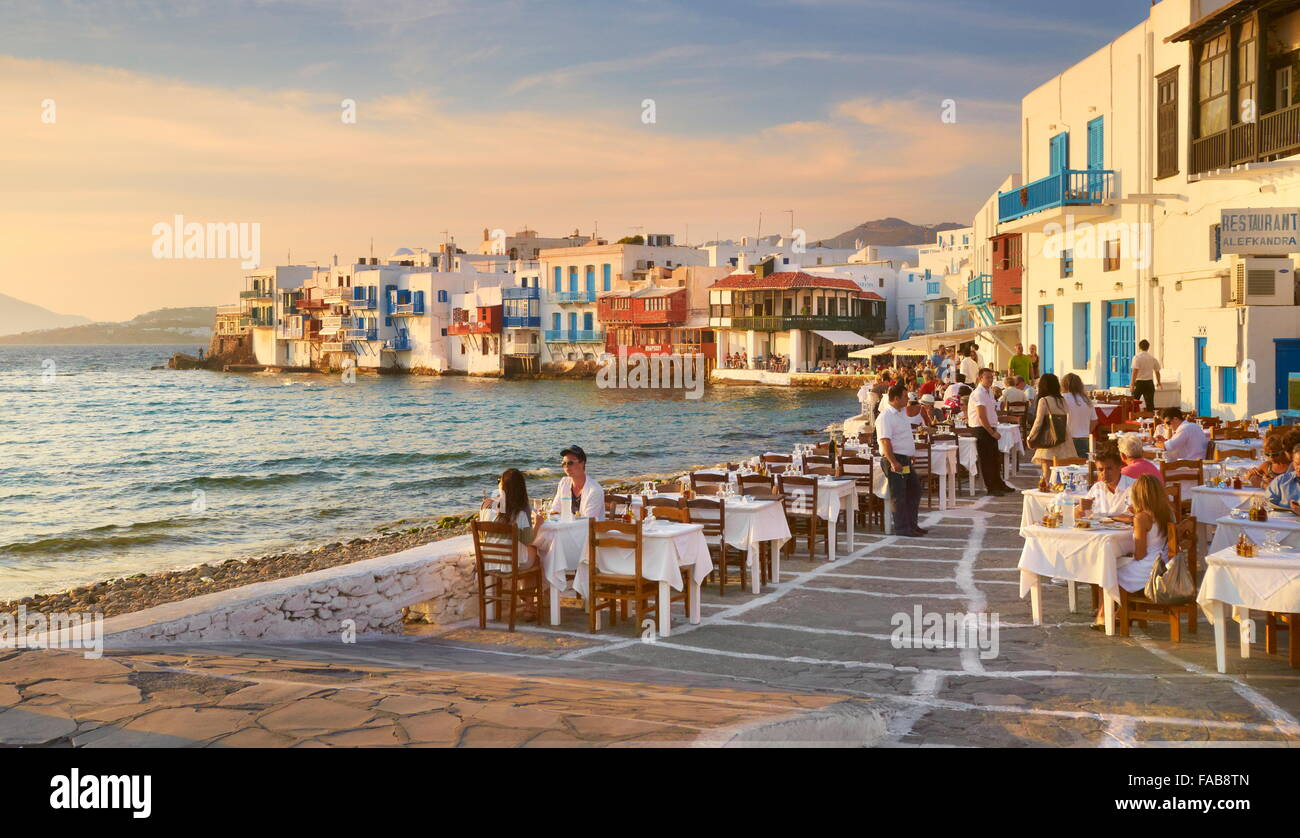 Outdoor restaurant  Mykonos Island Old Town  Little Venice in the     Outdoor restaurant  Mykonos Island Old Town  Little Venice in the  background  Greece